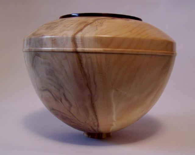 Poplar hollow form with walnut rim  $350